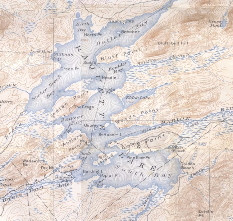 1903 USGS Raquette Lake Quadrangle shows numerous structures on the lakeshore and nothing on the point.