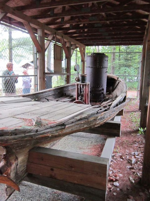 The remains of Buttercup were raised from the lake bottom in 1959 and are exhibited behind the Long Lake Town Hall.  Photo courtesy of Diane Chase and adirondackalmanac.com